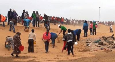 CLEARING LAND, About 1 000 people armed with shovels participated in clearing 68 plots at Walvisbay