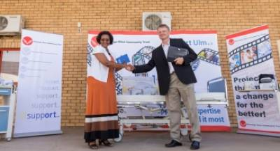 Deputy Executive Director, Ms. Bertha Katjivena, receives the donation of medical equipment.