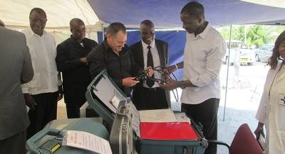 Hon. Dr Haufiku inspects some of the scopes which were part of the donation.