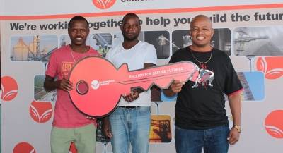 Josefa Tjikua, Mulunga Elifas and Kevin Hitjii, displaying the symbolic key to their secured homes