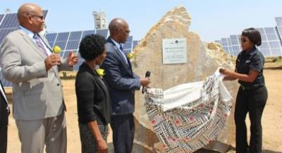 Minister of Mines and Energy Hon Tom Alweendo unveils the plaque