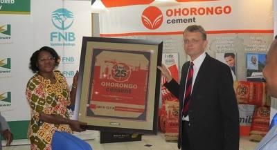 Mrs Nangula Mbako received framed limited edition celebratory bag.