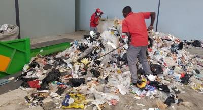 Non-recycle material being prepared for shredding at Rent-A-Drum's RDF processing plant