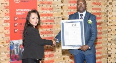 NSI CEO Chie Wasserfall hands over the Certification certificate to Ohorongo cement's Divisional Pro