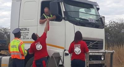 Ohorongo employees engaging a truck driver during the road safety awareness campaign