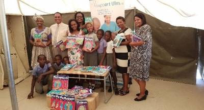 Teacher and leaners of Green Leaves Primary school, ecstatic about their new educational material.