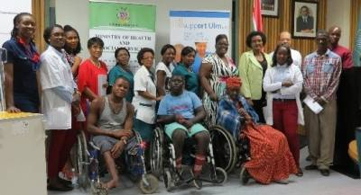 Three of the wheelchair recipients, together with the Deputy Minister of Health and Social Services.