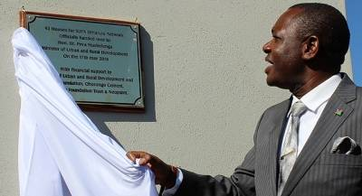 Urban and Rural Development minister Peya Mushelenga  unveiling a plaque of one of the 92 houses